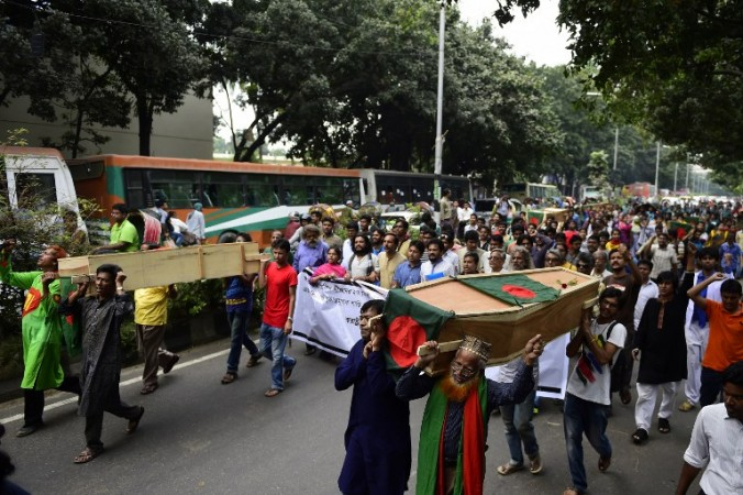 Bangladeshi activists shout slogans as they march in the street with mock coffins, that symbolize the deaths of secular publishers and bloggers, in Dhaka on November 5, 2015. Secular activists marched with mock coffins to protest the recent murder of a publisher and attempted murder of writers and bloggers that have been claimed by Islamic extremists. Photo: Munir uz ZAMAN / AFP