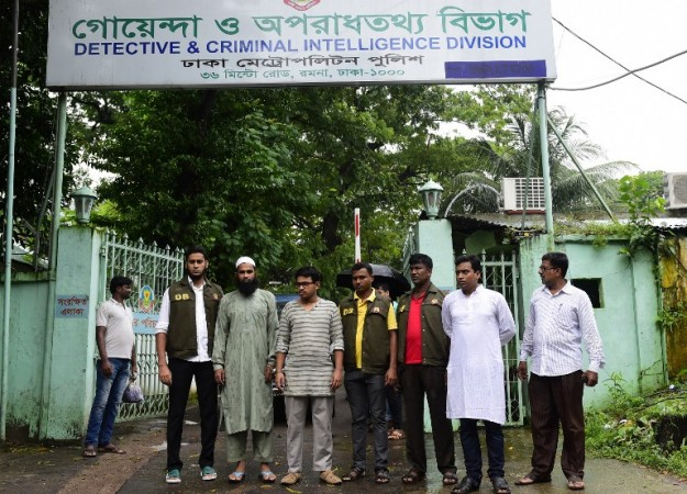 Bangladesh police officials parade suspects in Dhaka on August 14, 2015, after their arrest in connection with the murder of secular blogger Niloy Chakrabarti. , known by the pen-name Niloy Neel. Bangladesh police said they arrested two suspected members of the banned Islamist group, Ansarullah Bangla Team, over the brutal killing of 'atheist blogger' , known by the pen-name Niloy Neel. Photo: MUNIR UZ ZAMAN / AFP