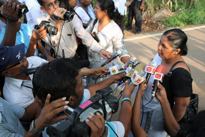 Sri Lankan journalist and cartoonist Prageeth Eknaligoda has been missing since January 2010. In the years since his wife, Sandhya, has led a massive campaign calling for justice. She talks to reporters outside a Colombo Court in March 2016 during the trial of those charged with his abduction. Photo: Sunanda Deshapriya