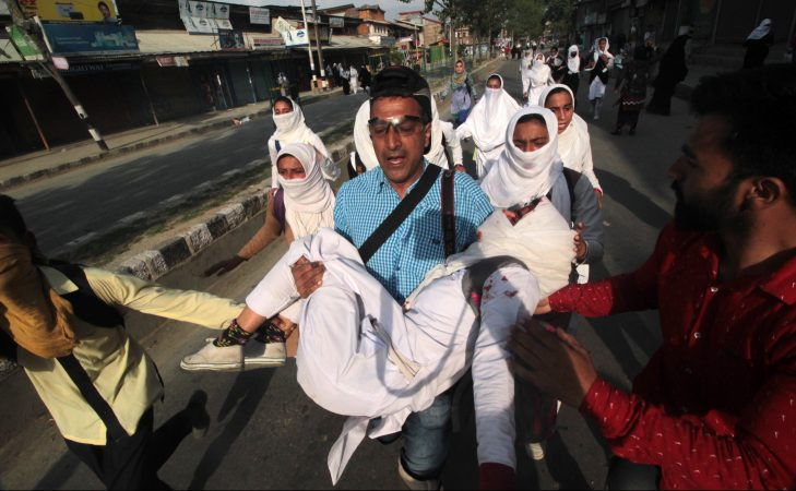 On assignment covering clashes in Srinagar in April 2017, photojournalist Dar Yasin put aside his camera to rush an injured school girl to hospital. On April 26, the government of Jammu and Kashmir announced a ban on networking sites and applications including Facebook, Whatsapp and Twitter in Kashmir on the grounds that these were being misused by anti-national and anti-social elements to fan trouble. The ban will be in place for at least one month or until further notice. Credit: Faisal Khan